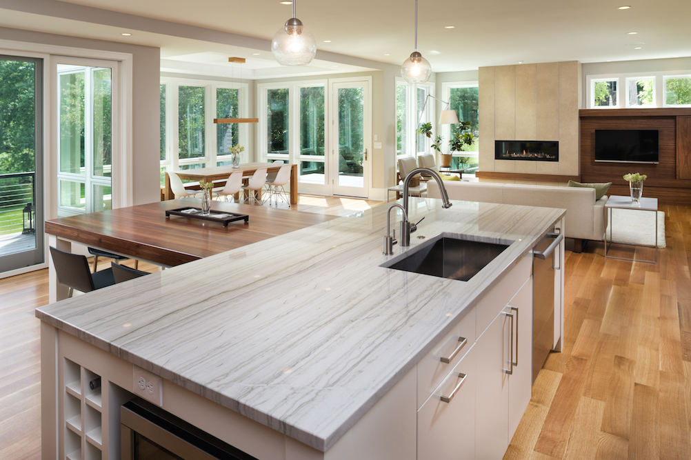 Stone countertops & island in kitchen by C&D Granite